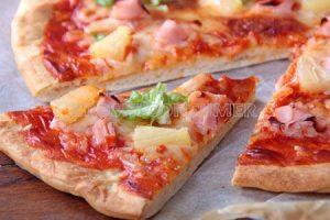 Pizza hawaiana, de jamón y piña