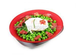Guisantes con jamón y huevos escalfados